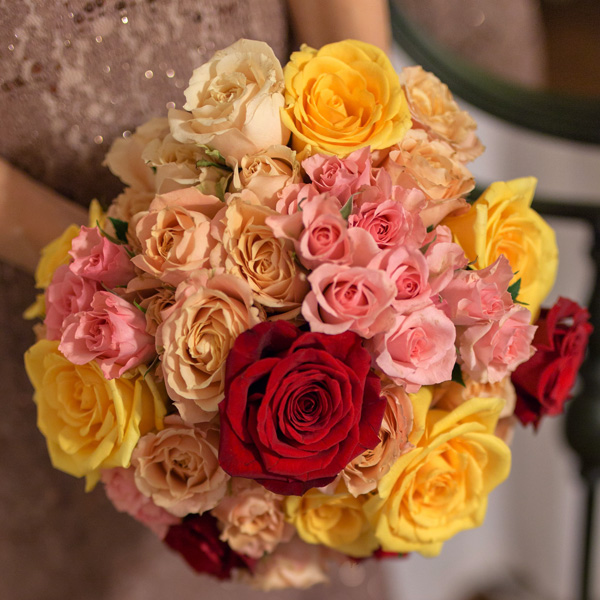 Bee Inspired Events - Warm color roses bridal bouquet