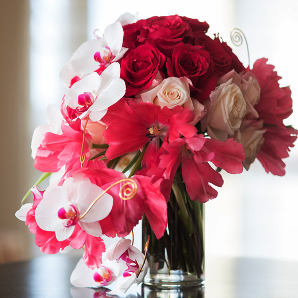 Bee Inspired Events - Orchids, fuchsia roses and tulips centerpieces