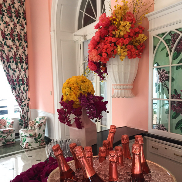 Bee Inspired Events - Groom's room showered with flowers and champagne